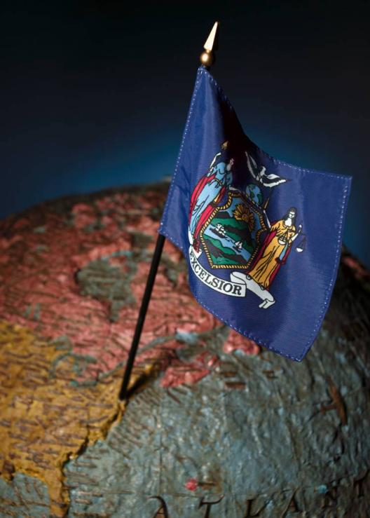 This is a picture of the flag of New York State, stuck into a globe.